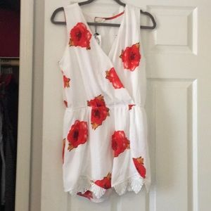 Floral printed white romper. Never worn. Size L